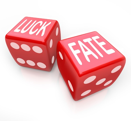 destiny: Two red dice featuring the words Luck and Fate representing putting your future at risk when you gamble for money in a game of chance and fortune
