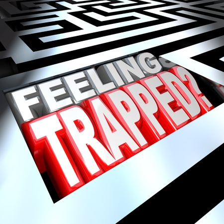 3d illustrated words Feeling Trapped in a maze to represent the difficulty of a hard problem or trouble that is keeping you lost in confusion behind barriers or obstacles Stock Photo - 10599149