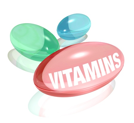 supplement: Three colorful vitamins - one red, green and blue - on a white background