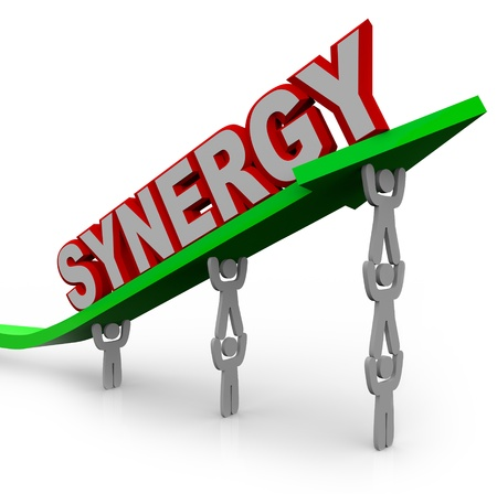 improving: A team of people lift an arrow and the word Synergy, illustrating the growth that can be achieved with many team members working toward a common objective and forming a partnership or alliance of different strengths and abilities
