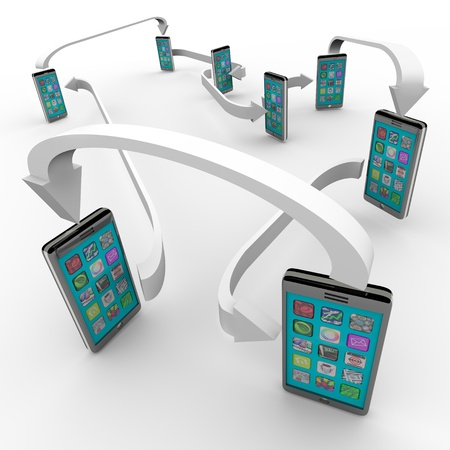 A number of smart phones with apps on touch screens are connected with arrows symbolizing a network of sharing and communication technology photo