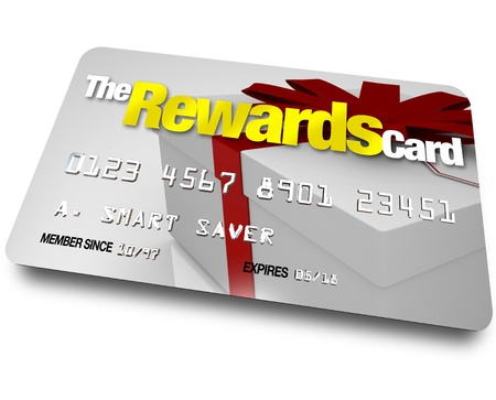 A credit card with the name The Rewards Card and a present shown on it illustrating the benefits, refunds and rebates you can earn by using a membership account when buying Stock Photo - 10913342