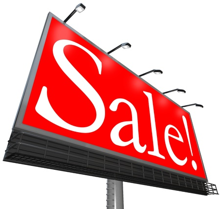 The word Sale on a red background on an outdoor billboard sign advertisement to attract customers to a special discount event at a store Stock Photo - 10978051