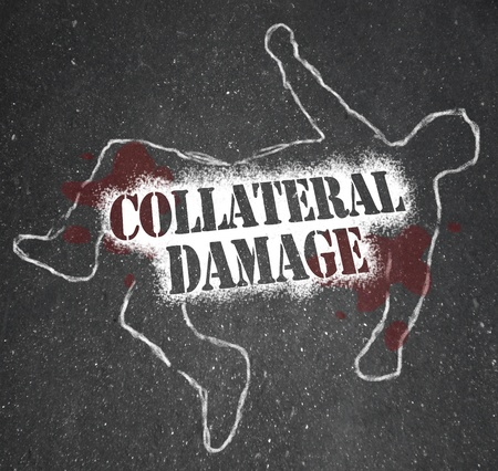 downsizing: A chalk outline of a dead body and the words Collateral Damage representing a civilian who was killed unintentionally in a battle or symbolic of a worker who is let go in reorganization or downsizing