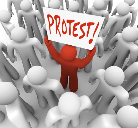 complain: A person holds a sign reading Protest to demonstrate a complain and rally for change and revolution to demand a solution to a problem