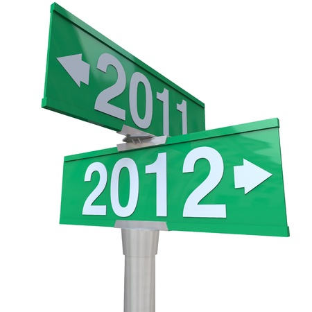 A green two-way street sign pointing to the years 2011 and 2012 with arrows leading to the past or the future, perfect for a symbol of the new year and the changing of times