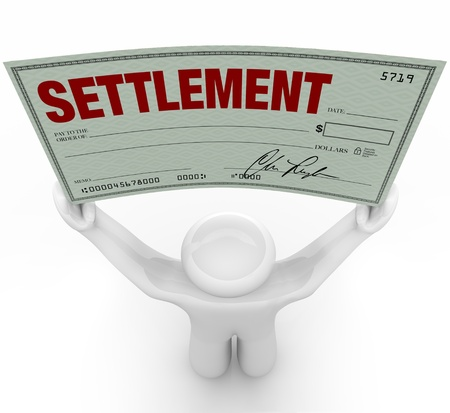 the settlement: A man holds a large settlement check that he has won in a trial in civil court proceedings after the other party agreed to settle the case