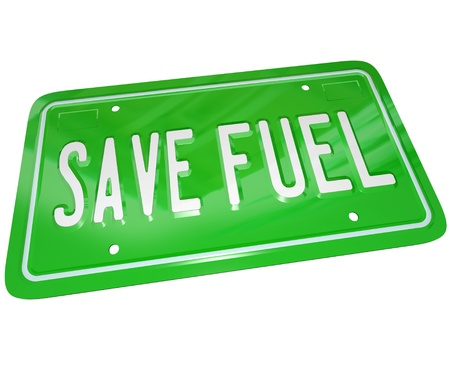 fuel economy: A green metal license plate with words Save Fuel illustrating the importance of gas savings and finding alternative power sources for transportation