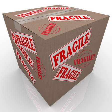 flimsy: A cardboard box used to ship goods or items with stickers all over it marked Fragile telling the handler or delivery service to handle the package with care