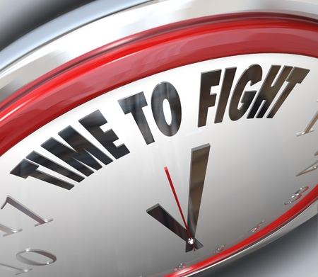 complain: A clock with the words Time to Fight illustrating the urgency of standing up for your rights and demonstrating to those in power that you wont back down Stock Photo