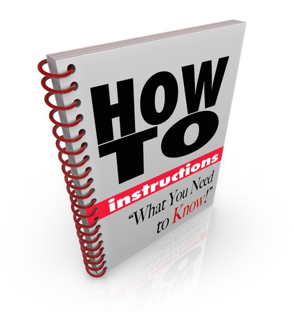A spiral bound book with the words How To Instructions What You Need to Know, a manual offering guidance and tips on accomplishing a chore, task or self-improvement goal Stock Photo - 11826635
