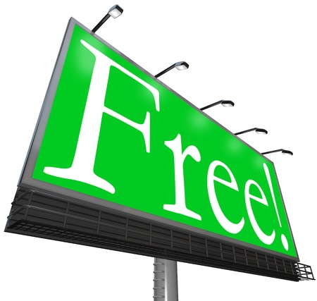 The word Free on a green background on an outdoor billboard sign advertisement to attract customers to get a giveaway object or no-cost product Stock Photo - 11826642