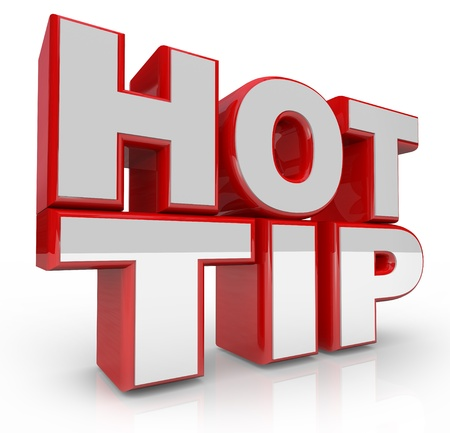 The words Hot Tip in 3D letters to offer suggestion or information for success or solution to a problem photo