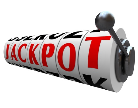 The word Jackpot appears on slot machine wheels illustrating the money payout of a game or form of gambling photo