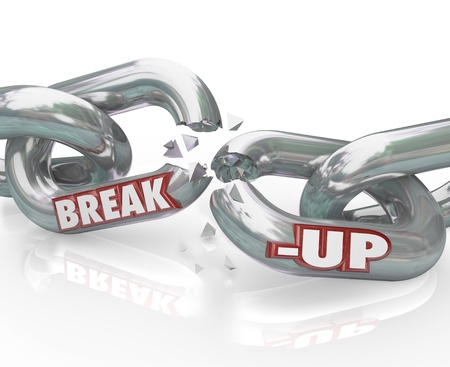 breaking up: Two metal chain links broken with the words Break-Up to represent a separation or divorce, or the ending of a relationship or partnership
