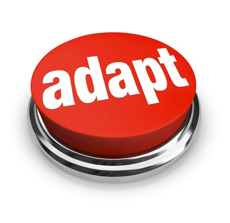 surviving: A red button with the word adapt on it, representing the desire to affect instant change and quickly be adaptive to chaingng business or life conditions