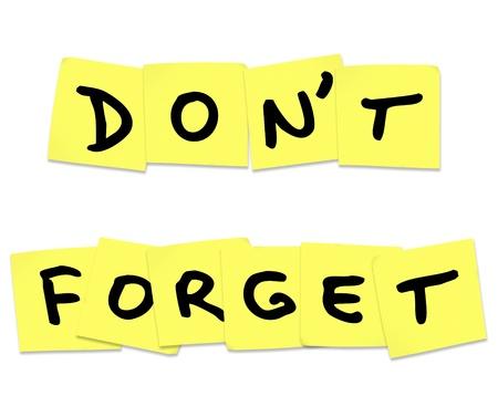 recordar: Las palabras no se olvide escrito en las notas adhesivas amarillas para recordarle que debe hacer algo importante