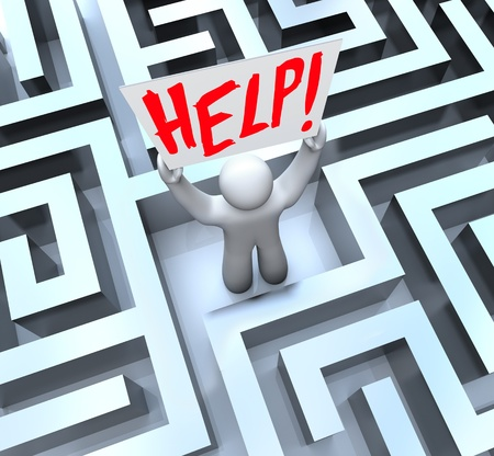 A man stands lost in the middle of a large, confusing maze or labyrinth and holds a sign reading Help Stock Photo - 12583680