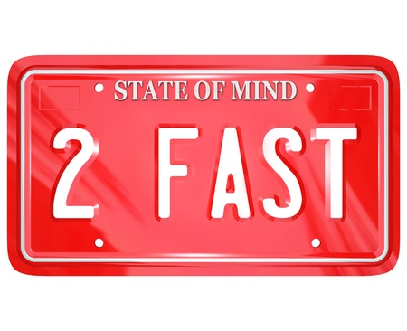 license plate: A red vanity license plate with the letters and words 2 Fast to symbolize a speedy driver or someone racing to beat his competition Stock Photo