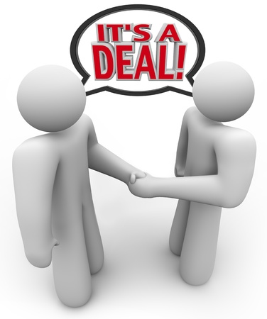 barter: Two people, a buyer and salesperson or seller, talk and shake hands with the words Its a Deal being spoken in a speech bubble above their heads to signify a completed agreement or financial transaction Stock Photo