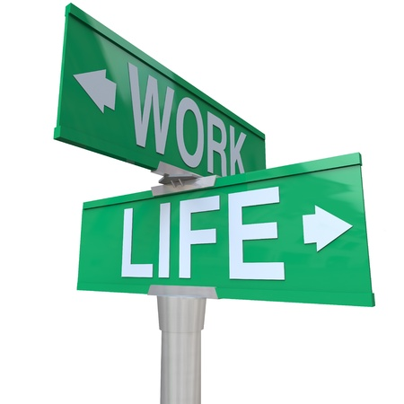 road work: A green two-way street sign pointing to the words Work and Life, symbolizing the balance of career and job with your family or home life and overcoming stress of an imbalance of time