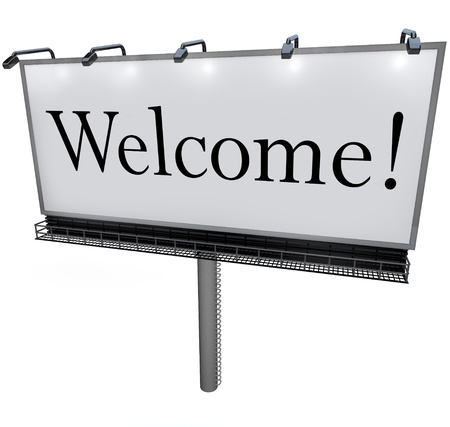 greet: A large white billboard with the word Welcome greets you to a new place, neighborhood, company, or store Stock Photo