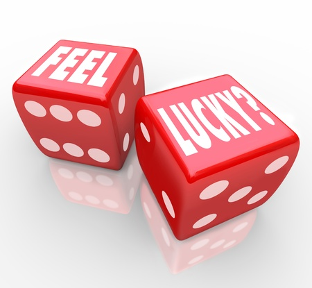 by feel: Two red dice with the words Feel Lucky asking if you are feeling confident in your chances to win a game or competition or take advantage of an opportunity for success Stock Photo
