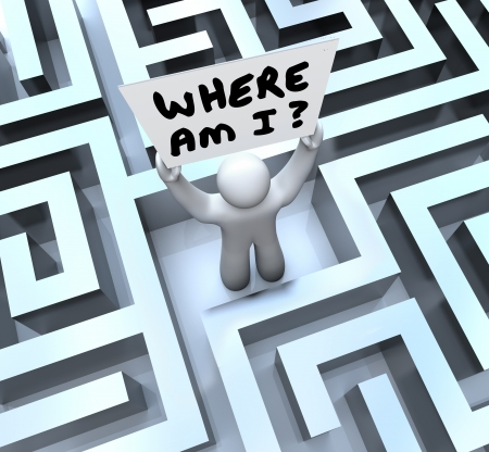 where: The words Where Am I asking the question of what is your location as you try to navigate your way out of a maze or labyrinth and seek help and answers from someone to rescue you