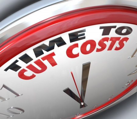 low cost: Watch your spending and reduce your overhead by paying attention to this clock telling you it is Time to Cut Costs and get your budget in order before you are in debt or bankrupt