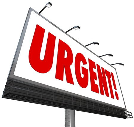 crucial: The word Urgent in big red letters on a white outdoor billboard sign to grab attention for an important, critical, crucial, vital and immediate message calling for action now