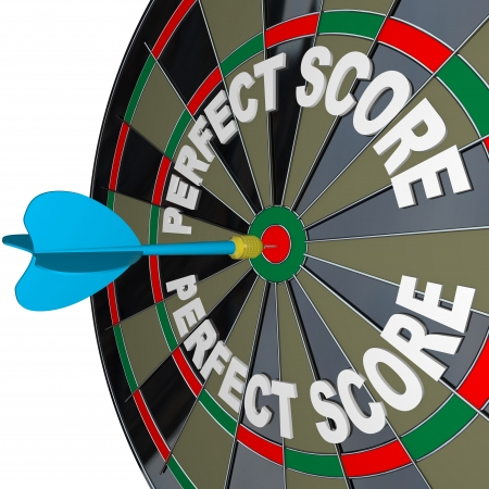 The words Perfect Score on a dartboard with one dart hitting the center to win the game with highest possible score and complete victory