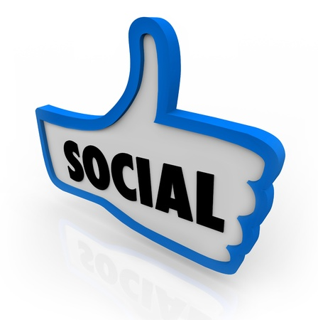 The word Social on a blue thumb's up symbol to illustrate a social network or other formate for online communication or discourse with friends, family and other people Archivio Fotografico