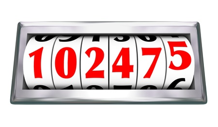 scoring: Numbers on a progressing odometer with wheels turning to indicate advancing miles and age of automotive transportation Stock Photo