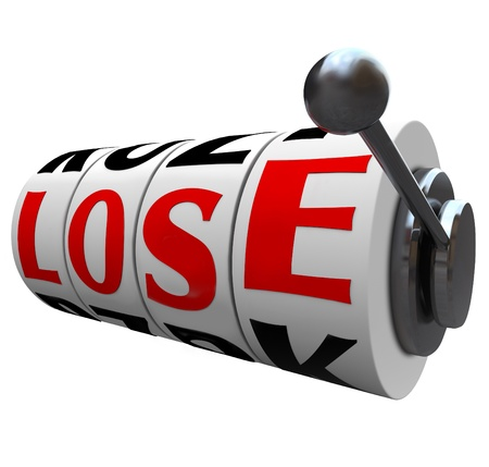 betting: The word Lose spelled out in letters on slot machine wheels to indicate  you have lost the game or competition, or are the loser in a financial investment or gamble
