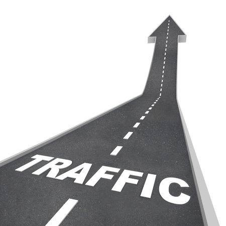 advance: The word Traffic on a road rising up to represent increased activity on the web or transportation system such as freeways and highways Stock Photo