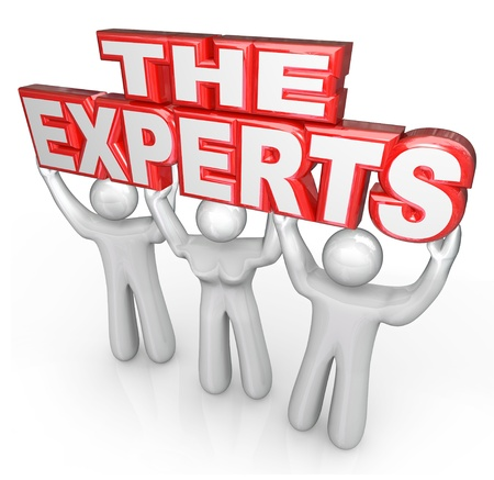 The words The Experts lifted by three people 스톡 콘텐츠