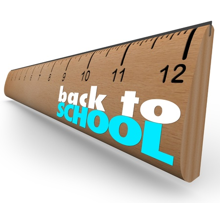 The words Back to School on a wooden ruler photo