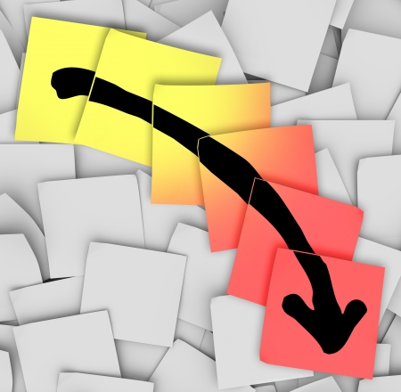 An arrow pointing downward drawn on yellow and red sticky notes, illustrating failure, negative movement, loss of money or assets and unsuccessful efforts Stock Photo - 14075603