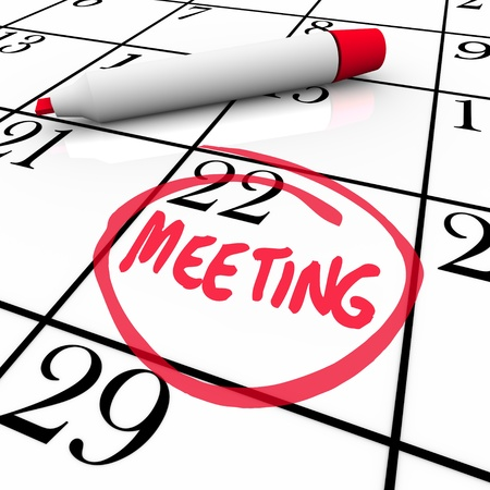 A red marker circles the word Meeting on a calendar background= photo