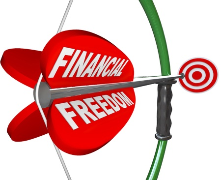 An arrow reading Financial Freedom is aimed with a bow at a bulls-eye targeting wealth, independence in finances, economic security and comfortable retirement Stock Photo