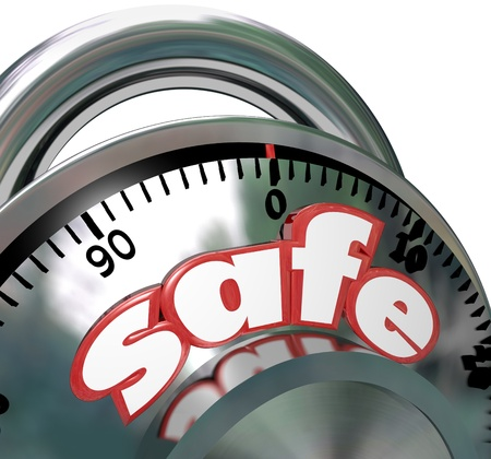 protection risks: The word Safe on a shiny metal combination lock giving you peace of mind that your assets are protected and have security from risk