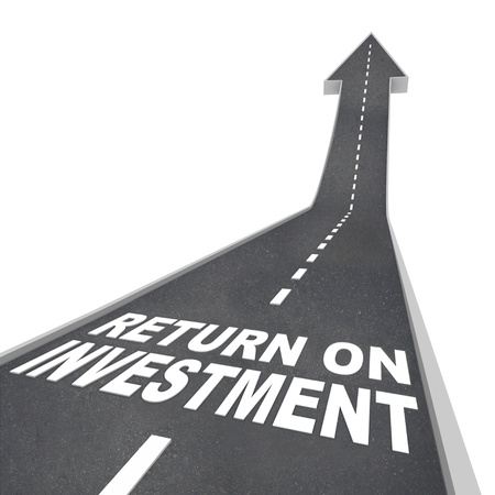 bigger: The words Return on Investment on a road leading upward, representing growth or improvement in your savings and financial nest egg, growing your wealth and income  Stock Photo