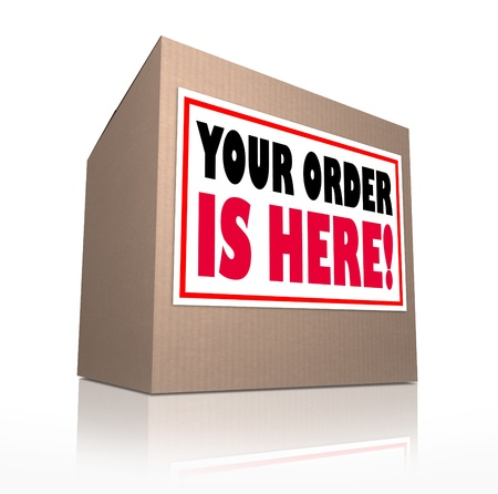 shipped: A cardboard box delivered with the words Your Order is Here to tell you that the merchandise you shopped for at a store has been shipped and is waiting for you to open it