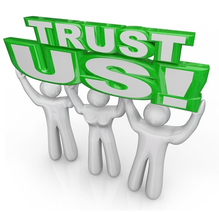 trusting: Trust Us words lifted by team of three people to symbolize a promise or guarantee by people seeking credibility and faith