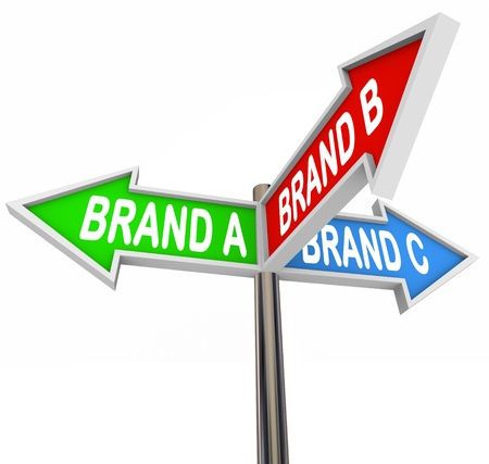 which: Several street or road signs marked Brand A, B and C pointing you in the direction of the best brands to choose in a crowded marketplace Stock Photo