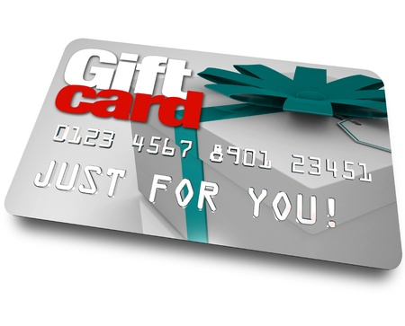 The words Gift Card on a plastic credit or debit card used for buying merchandise from a store as a gift or special present Banco de Imagens