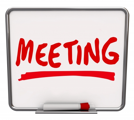 The word Meeting written on a dry erase board with a red marker, promoting a presentation, meetup, discussion or other information sharing event or session Archivio Fotografico