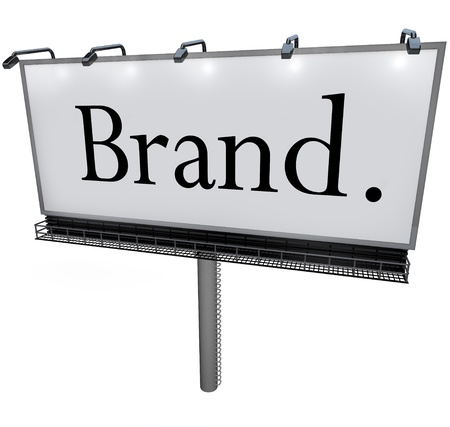 The word Brand in black letters on a blank white billobard to advertise a product or company with a marketing message to build loyalty, awareness and identity photo