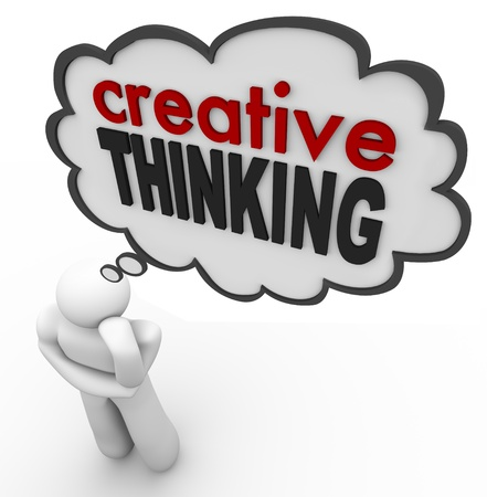 create idea: A person thinks of the words Creative Thinking to represent brainstorming, thought, creativity, inspiration, innovation and invention
