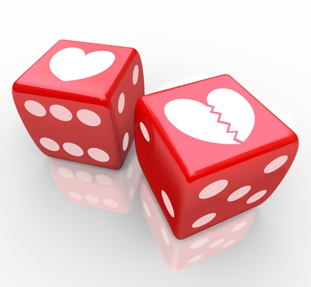heartbreak: Two hearts on dice, one broken to symbolize the risk in love, dating, relationships, marriage and divorce in the game of sharing your heart with someone else